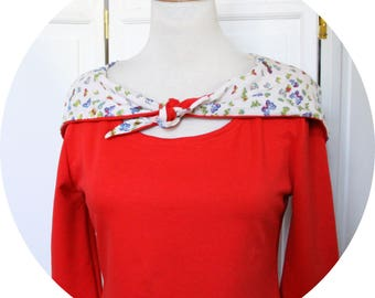Top has red and white jersey hood, sleeves three quarter red top has hood, sleeves three quarter red top, Red Hooded tshirt