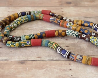 Long Strand of Mixed Design African Sandcast Tube Beads - ASC - 137