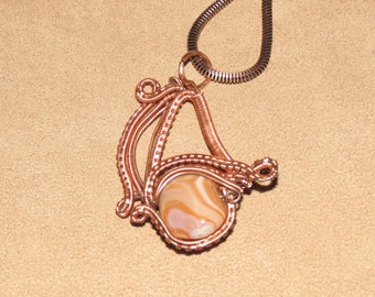 340 V complex darkened copper swirl agate golden eye