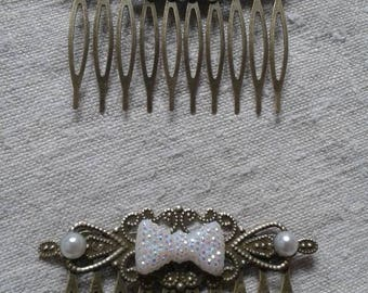 set of two small Combs white rhinestone bow