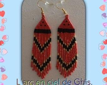 Red fringe dangle earrings.