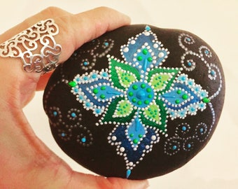 Blue-and-green hand-painted flower rock