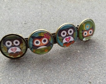 Brass bar with 4 glass cabochons