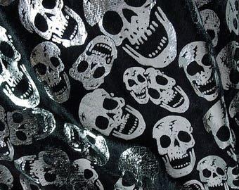 Velvet coated with silver skulls bluescreen