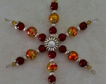 Fall color beaded snowflake ornament with sunflower charm