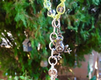 Garden charms to hang in your garden or patio made with green hemp, glass beads, frog charm and ribbons