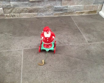 Rare vintage Christmas Santa on Wheels toy Rosbro