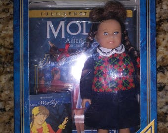 Molly an American girl DVD, mini doll, and book