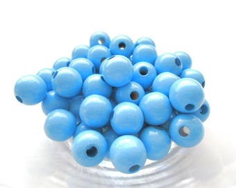 25 wooden pacifier clip 12 mm - sky blue beads