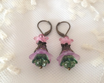 Earrings lucite pink, mauve and green.