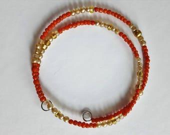 Orange and gold beaded memory wire bracelet