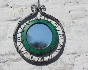 Round leather and steel hanging mirror