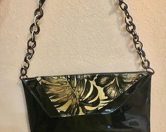 Black pochette with gold leaf in leather