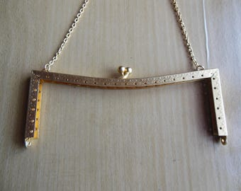 Bag in gold metal clasp
