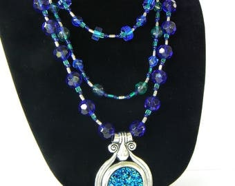 Blue three-tiered glass bead necklace