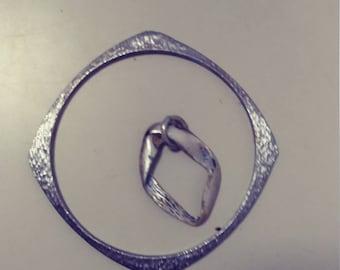 Metal bracelet with pendant