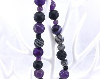 Gorgeous Lava Bead Bracelet with a Cross Charm.