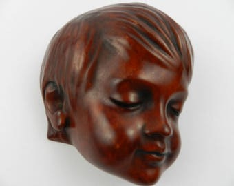 Wall mask of a young boy - Achatit, Germany