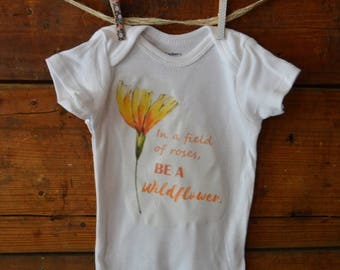In a field of roses, be a wildflower baby sunflower onesie