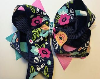 Floral Print on Navy Boutique Bow, Pink, White, and Cyan Spikes, Cyan Rhinestone Center on White Grosgrain