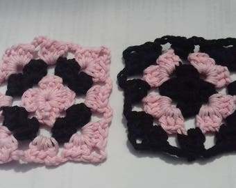 One pair of co-ordinating crochet granny square coasters (pink and black)