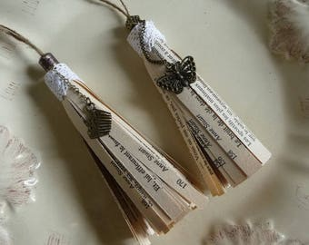 Set of two pom poms or tassels made of old book and lace