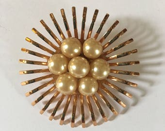 Gorgeous Coro signed gold tone brooch with pearl in center.