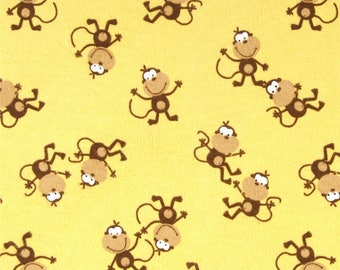 Fabric 4+ yds Monkey Flannel 100% Cotton Yellow background and features a pattern of silly little monkeys