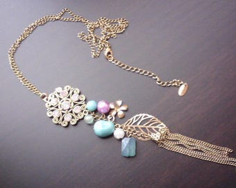 Long necklace filigree pamphlets and pearls of colors.