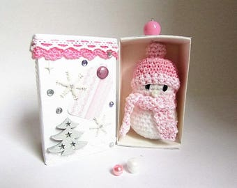 gift box with pink hanging crochet snowman