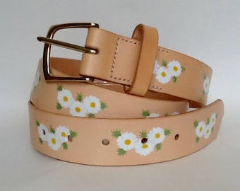 "1 1/4"" wide handmade hand painted natural leather belt with a solid brass buckle and decorated with a floral design"