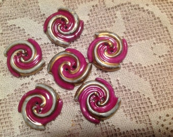 Set of six porcelain buttons, spiral shape