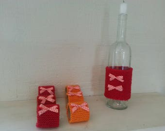 carafe, candle holder, soliflor: dressing red bottle embellished with a bow orange with white dots