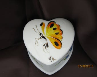 small heart painted white porcelain with a beautiful Butterfly