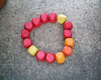 orange bracelet with red yellow wooden beads