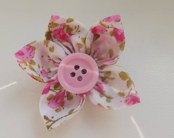 Pink fabric flower brooch.