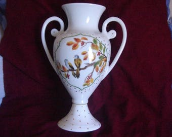 hand painted vase with porcelain handles
