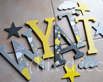 Child's name in wooden letters painted and decorated to hang theme babyfan (made to order)