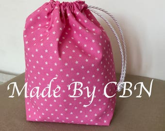 Great little cotton bag pink flashy and printed white stars, which closes with white satin cord DrawString ties