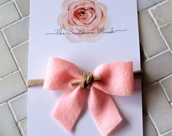 Adorable light pink feelt headband wrapped with Suede tie