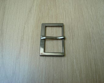 Dark silver metal belt buckle