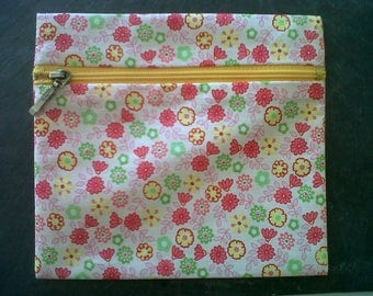 Zipped pouch printed with flowers, pink yellow and green