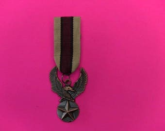 military medal type brooch ready to ask