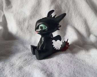 "Figurine of a Toothless Bezzubik from ""how to train your Dragon"""