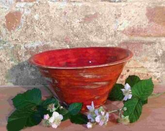 Medium dark rustic orange/red ceramic bowl