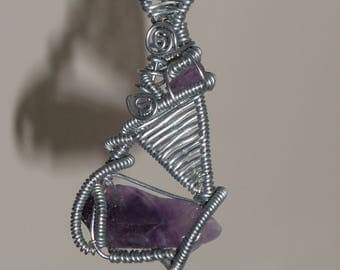 """Pendant """"flute player"""" and its amethysts"""