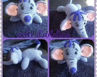 a pretty purple elephant in lying position