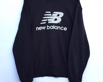 NICE!! Black NEW BALANCE big logo pull over sweatshirt good condition !!
