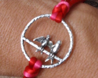 Red and Fuchsia pink cord bracelet and silver metal. Birds love.