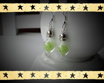 globe-shaped transparent green microbead filled glass mounted on earrings